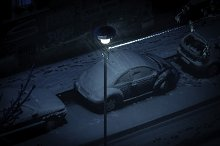 cars parked snow blizzard night by  in Abstract