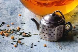 Cup of hot tea with tea strainer