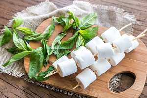 Marshmallow skewers on the board
