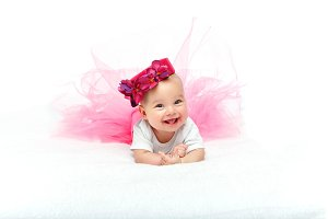 happy beautiful baby girl with pink