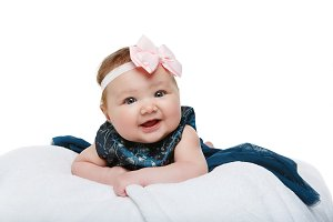 happy beautiful baby girl with bow