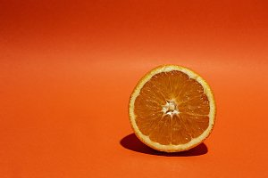 Fresh Oranges on orange background