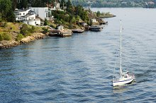Yacht sailing past Sweden coastline