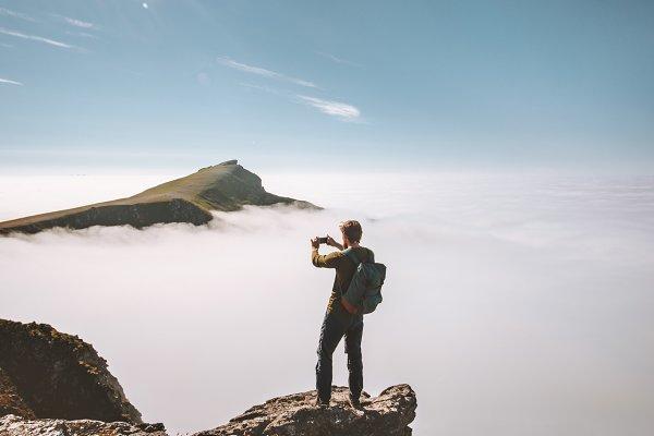 People Images: e v e r s t - Man traveler taking photo smartphone