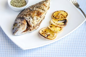 Grilled dorada fish with lemon
