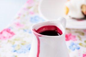 Berry sauce in white milk jug