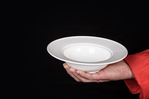 male hand holding empty plate