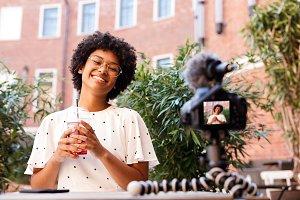 Happy woman recording a video