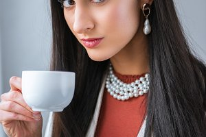 beautiful brunette woman holding cup