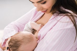 young mother breastfeeding little ba