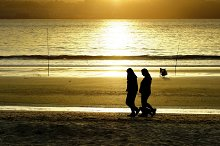 women silhouettes in the beach