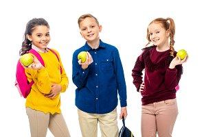 cute schoolchildren with backpacks h
