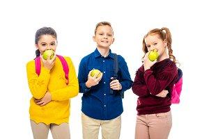cute schoolchildren with backpacks e