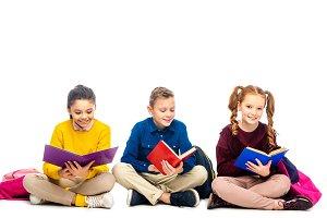 smiling schoolchildren sitting and r