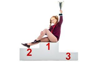smiling schoolgirl sitting on winner