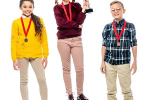 smiling preteen kids with medals and