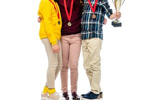 happy kids with medals and trophy cu