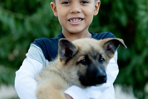 Latin child with his dog