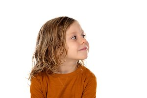 Small blond child imagining somethin