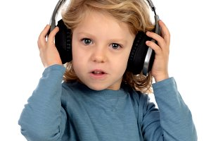 Happy blond child with headphones an