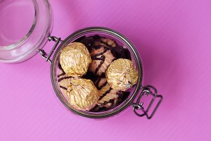 Glass jar with sweets and cookies