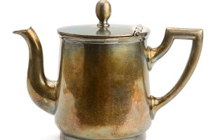 Ancient copper kettle isolated on wh