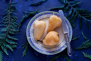 Ripe peeled pears on a plate and kni