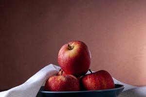 Red apples inside fruit bowl
