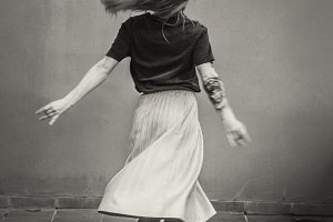 Young girl spinning.