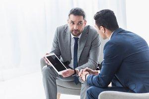 serious business mentor holding digi