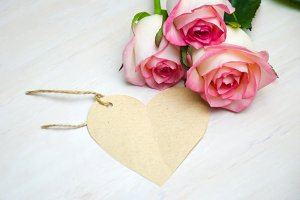 pink roses and tag, wooden heart