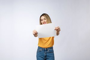 Excited woman showing empty blank