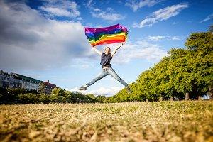 Jumping with rainbow flag