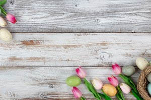 Easter tulips and colorful eggs