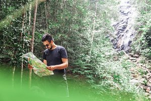 Handsome man trekking in jungle