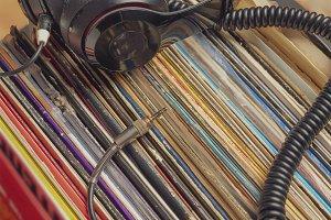 dark headphones lay on stack of retr