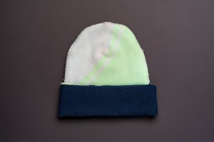 colorful woolen hat isolated on dark