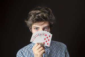 closeup portrait of teen male hold g
