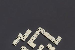 bright domino lay on dark background