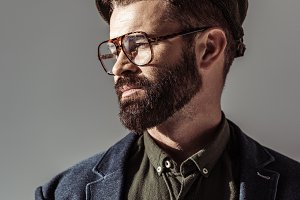 Handsome bearded man in glasses