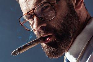 handsome bearded man smoking and loo