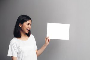 Young woman holding a blank poster f