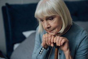 portrait of upset senior woman with