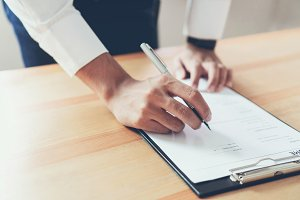 Businessman writing form submit resu