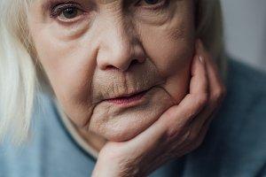 portrait of sad senior woman proppin