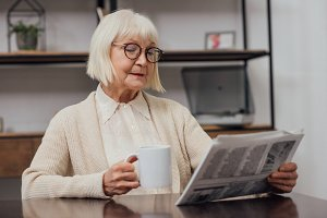 senior woman with grey hair sitting