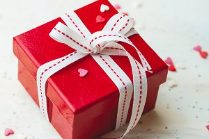Gift box with bow ribbon and heart
