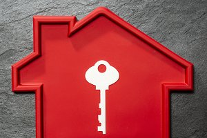 Red colour house shape and white key