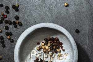 Black pepper in small bowl for spice