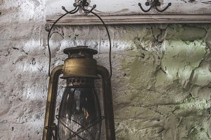 Old vintage lantern lamp on painted